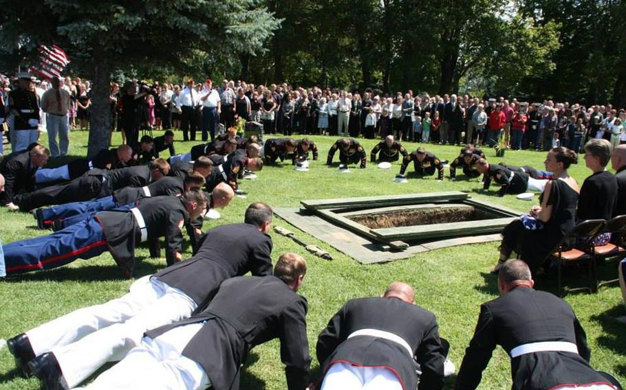 His fellow Marines do pushups at the burial for Gunnery Sgt. Daniel Price in 2012. Price was awarded the Silver Star for his heroic actions in Afghanistan that same year.