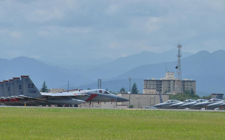 F-15 Eagle fighters assigned to the 18th Wing at Kadena Air Base, Okinawa are shown here at Yokota Air Base on July 9, 2018, after being evacuated there due to Typhoon Maria, which is forecast to reach Okinawa on July 10.