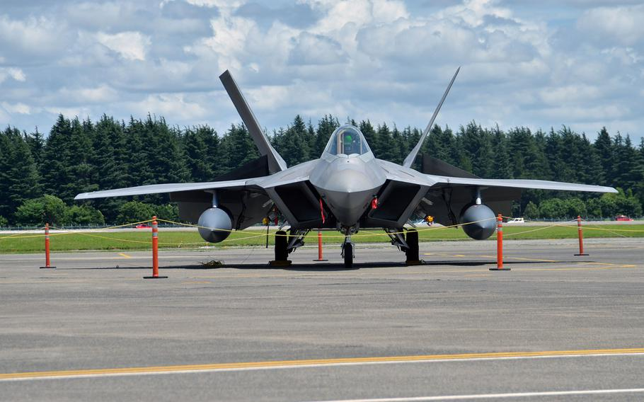 An F-22 Raptor stealth fighter operating from Kadena Air Base, Okinawa, sits on the tarmac at Yokota Air Base, Japan, on July 9, 2018 after being evacuated there due to the threat of Typhoon Maria, which is forecast to reach Okinawa on July 10.