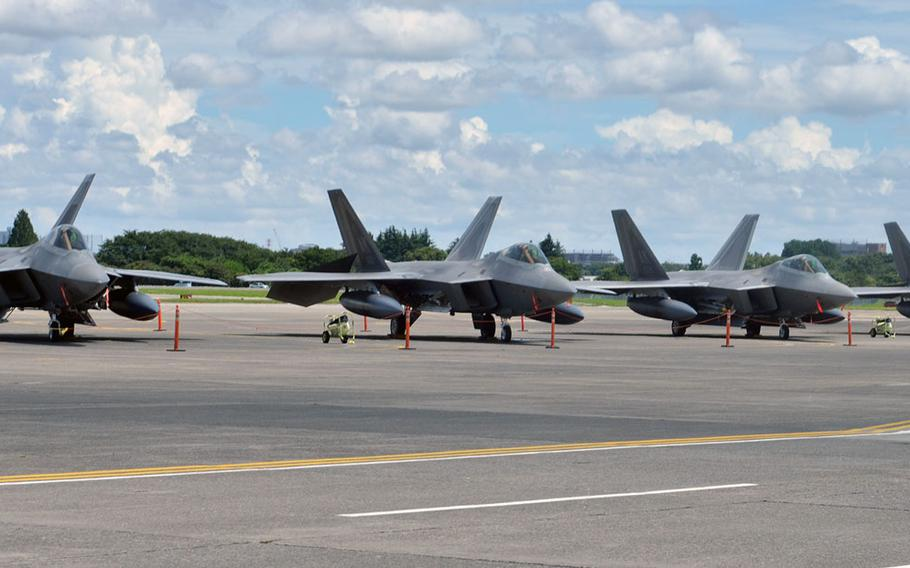 F-22 Raptor stealth fighters operating from Kadena Air Base, Okinawa, sit on the tarmac at Yokota Air Base, Japan, on July 9, 2018 after being evacuated there due to the threat of Typhoon Maria, which is forecast to reach Okinawa on July 10.