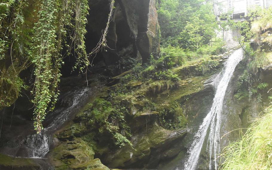 Larger and smaller waterfalls wind through the rocks and onto pools below at Grotte Caglieron, a series of caves and tunnels a short drive from Aviano Air Base, Italy.