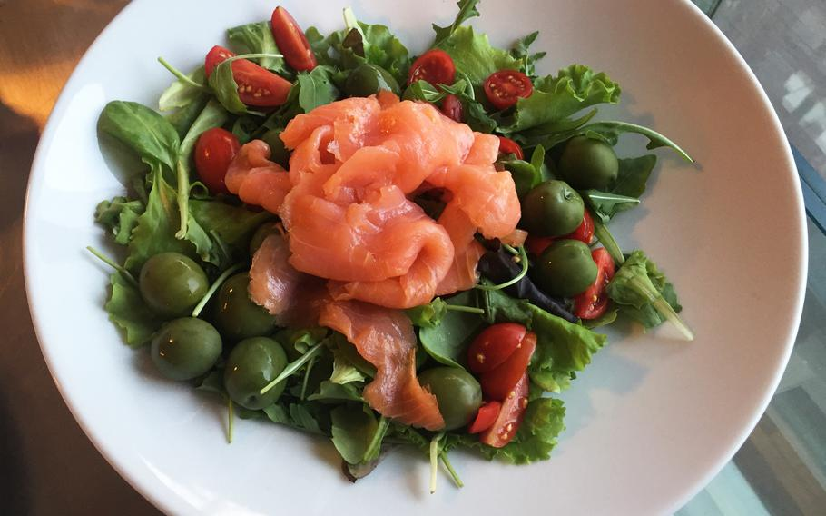 Raw salmon salad with green olives and juicy, sliced tomatoes. Grangusto's diverse menu includes many healthy seafood dishes.