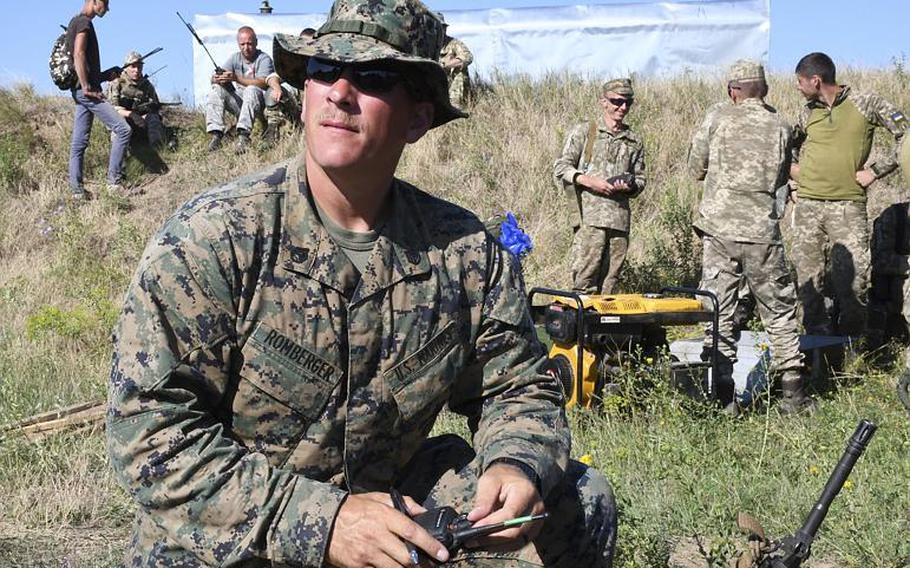Staff Sgt. Antony Romberger, platoon sergeant for the U.S. Marine Reserves' weapons platoon, Echo company, 2nd Battalion, 25th Regiment, prepares his gear for an assault with U.S and Ukraiian marines during Exercise sea Breeze on Saturday, July 14, 2018, at a military base near Mykolaiv, Ukraine.