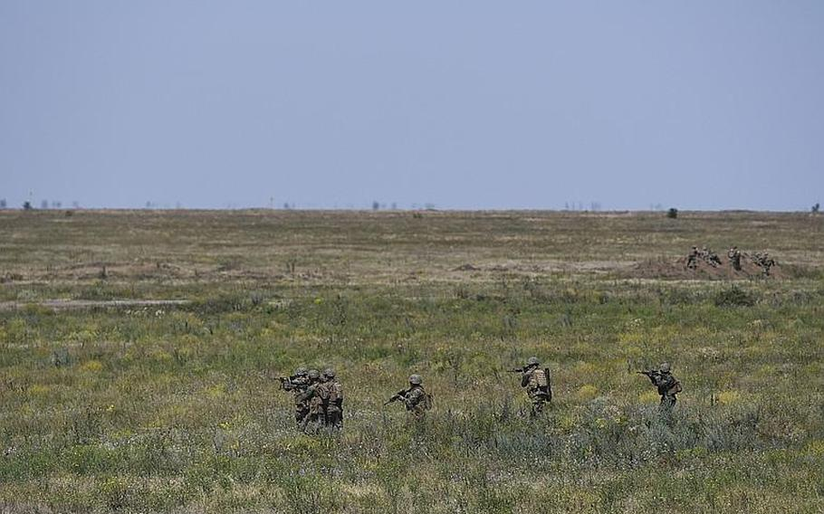 Marines move out on an assault course at a military base in the Mykolaiv Region of southern Ukraine on Saturday, July 14, 2018, during Exercise Sea Breeze, which brings together representatives from 19 NATO partner and allied troops to build interoperability across the alliance in the Black Sea.