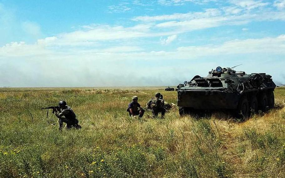 U.S. and Ukrainian Marines provide security near a Ukrainian BTR-80 armored transporter during a company-level attack at the land portion of Exercise Sea Breeze, Saturday, July 14, 2018.