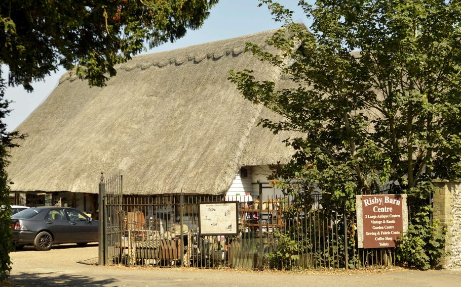 Entrance to the Risby Barn Antique Shopping Center in the village of Risby, England. The center features two antique shops, a garden center, coffee shop and sewing center called the Cosy Cabin.