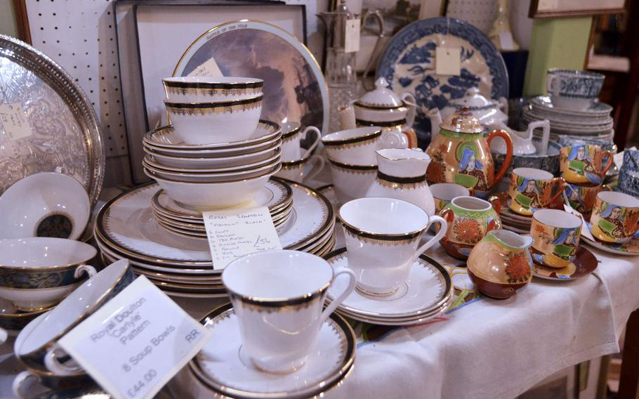 Some of the dinner sets for sale at the Risby Barn Antique Centre in the village of Risby, England.