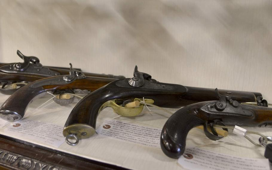 Flintlock pistols from the 1800s are among items for sale at the Risby Barn Antique Centre in the village of Risby, England.
