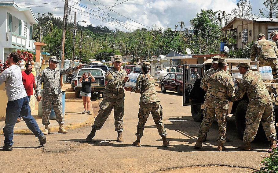 Soldiers of the Puerto Rico Army National Guard's 92nd Military Police Brigade distribute supplies, food and water to affected communities around the island of Puerto Rico in the aftermath of Hurricane Maria, Nov 2, 2017.