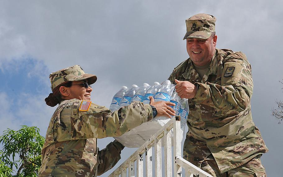 Soldiers of the Puerto Rico Army National Guard distribute supplies, food and water to affected communities around the island of Puerto Rico in the aftermath of Hurricane Maria, Nov 2, 2017.