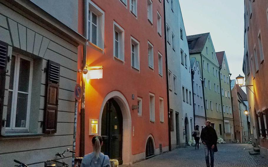 The entrence to Dragonbirds Sushi, down a narrow alley in Regensburg, Germany, Wednesday, May 2, 2018.