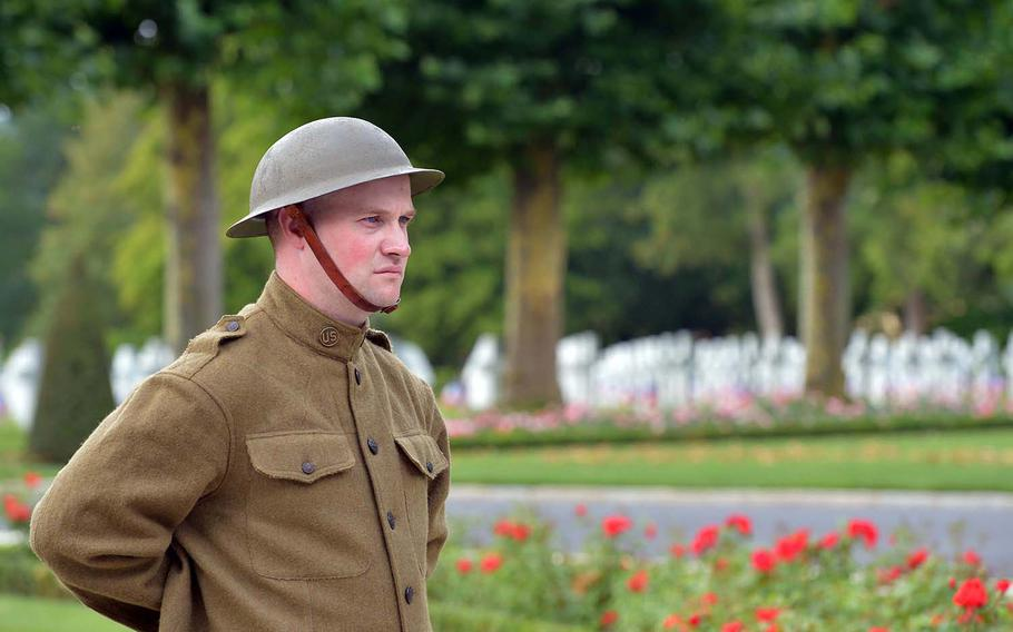 Dressed in a World War I-style uniform, Cpl. John Koenig of the 42nd Infantry Division, stands near the flag pole at Oise-Aisne American Cemetery at Seringes-et-Nesles, France. French and Americans marked the 100th anniversary of the Oise-Aisne Offensive at a ceremony at the cemetery.