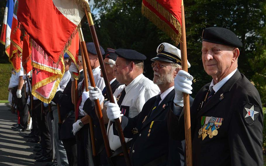 French flag bearers from local military societies stand at the beginning of the ceremony marking the centennial of the Oise-Aisne Offensive at Oise-Aisne American Cemetery at Seringes-et-Nesles, France, Saturday, July 28, 2018.
