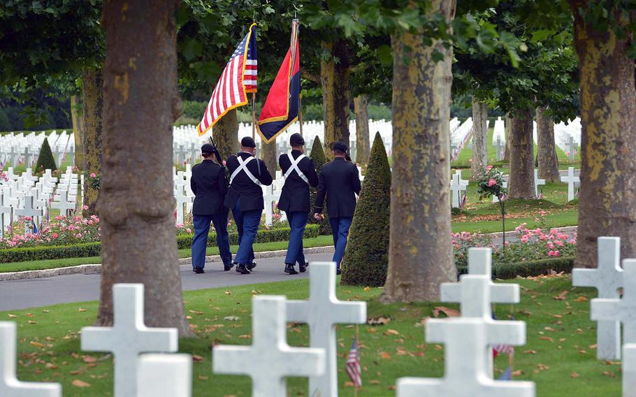 The 42nd Infantry Division color guard march off through Oise-Aisne American Cemetery at Seringes-et-Nesles, France, at the end of the the ceremony marking the centennial of the Oise-Aisne Offensive