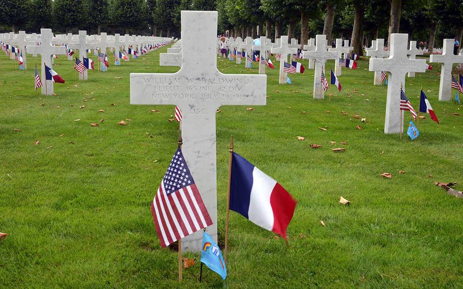 The graves at Oise-Aisne American Cemetery at Seringes-et-Nesles, France, are decorated with French and American flags for the ceremony marking the 100th anniversary of the World War I Oise-Aisne Offensive, Saturday, July 28, 2018. Graves of soldiers from the 42nd Division, known as the Rainbow Division, had their graves also marked with a Rainbow Division flag.