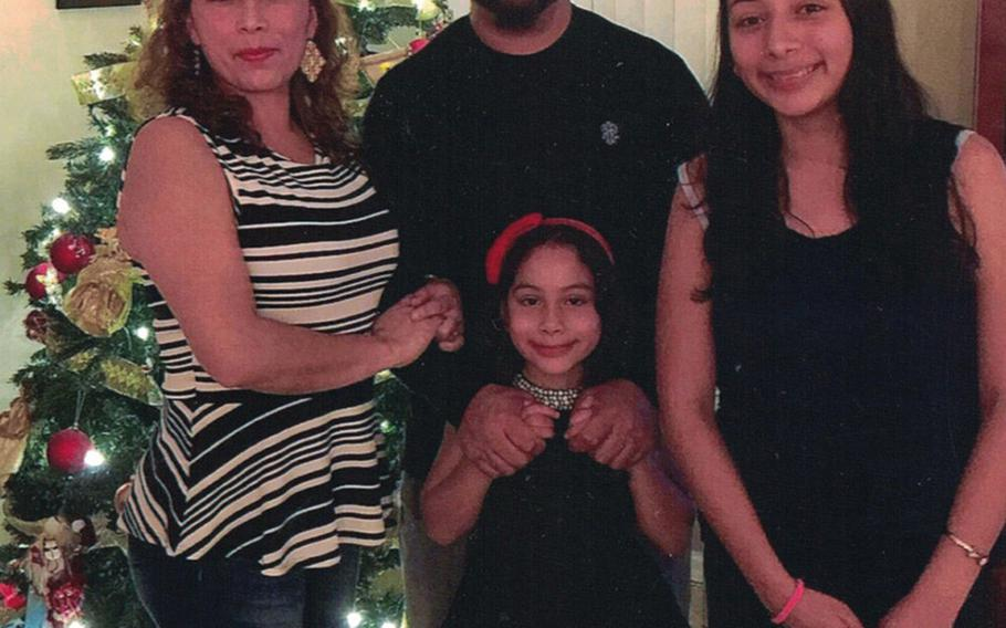 Alejandra and Temo Juarez and their daughters Estela, left and Pamela celebrate Christmas 2017 in Florida. Alejandra is facing deportation to Mexico this week after 20 years in the country as a military wife and mother of two American daughters.