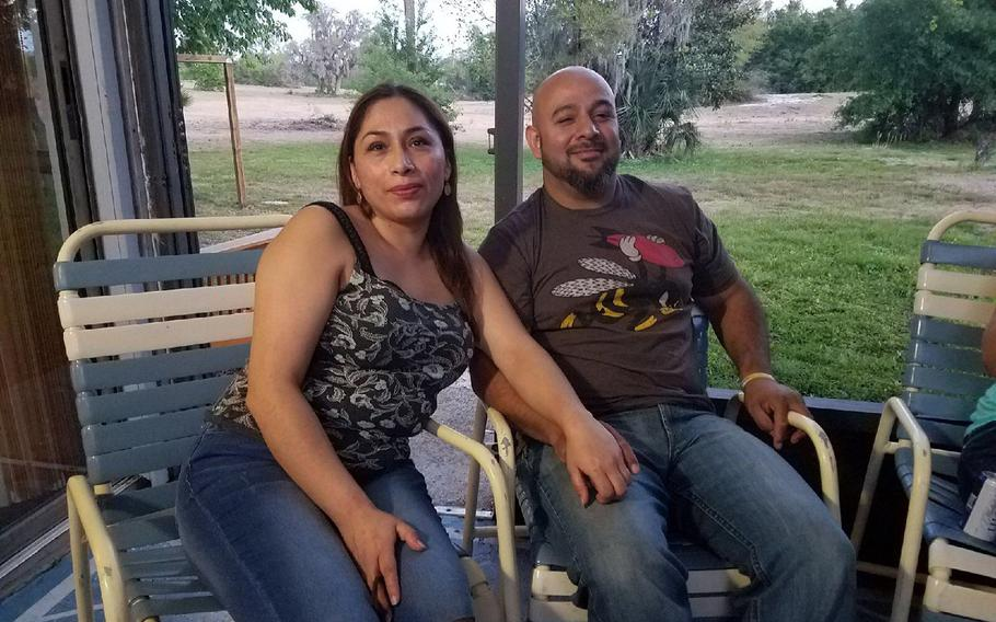 Alejandra Juarez, left, and her husband of 20 years Temo Juarez, an Iraq combat veteran, enjoy a barbecue with friends in April. Alejandra entered the country illegally in 1998 and was deported to Mexico Aug. 3, dividing the family of four.