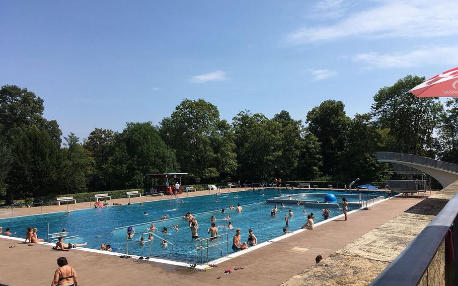 At the adult pool at Hoehenfreibad in Stuttgart, Germany, there are swimming lanes, high dives and an easygoing collection of bathers.