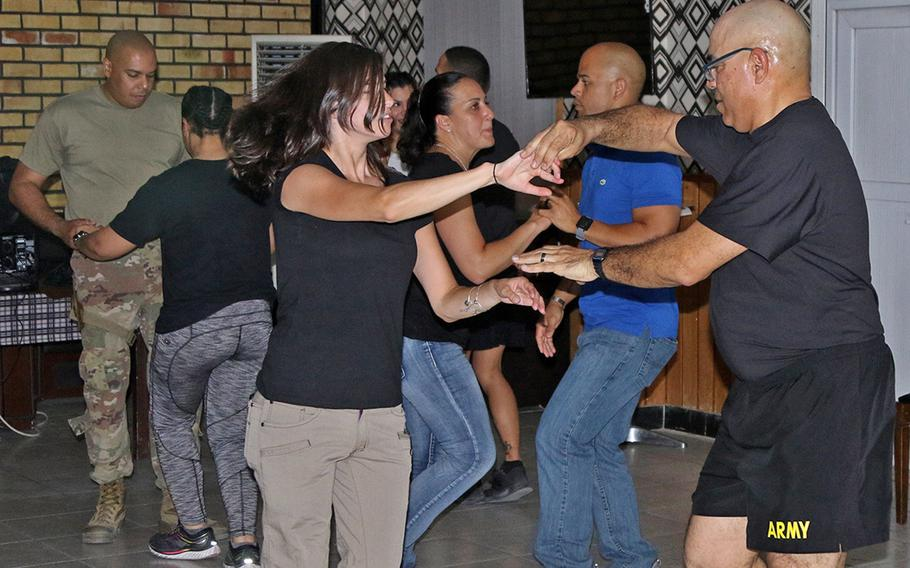 Soldiers of the Puerto Rico Army National Guard's 191st Regional Support Group Forward dance during salsa night in Kabul. Members of the Puerto Rico-based unit deployed to Afghanistan after helping those who lost everything in Hurricane Maria last fall.