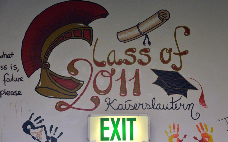 Artwork done by students of Kaiserslautern High School's class of 2011 adorns a wall above an exit in the old school building. For the first time in more than 65 years, no high school students will walk the hallways of the building. A new school is set to open at the end of August.