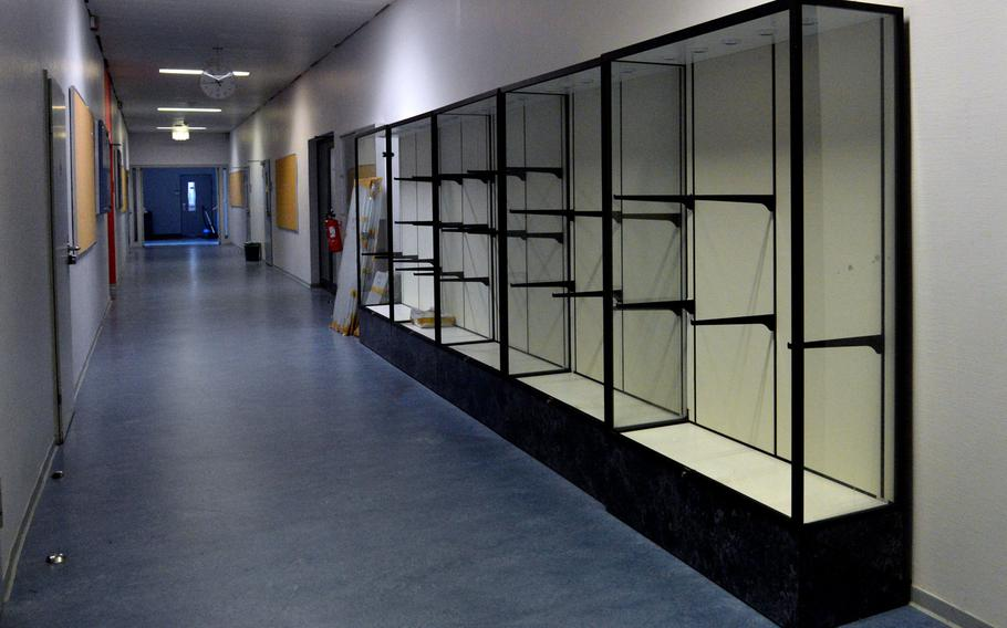 The trophy cases are empty in a hall of the old Kaiserslautern High School building. A new high school will open at the beginning of the new school year, at the end of August, and the trophies will be on display there.