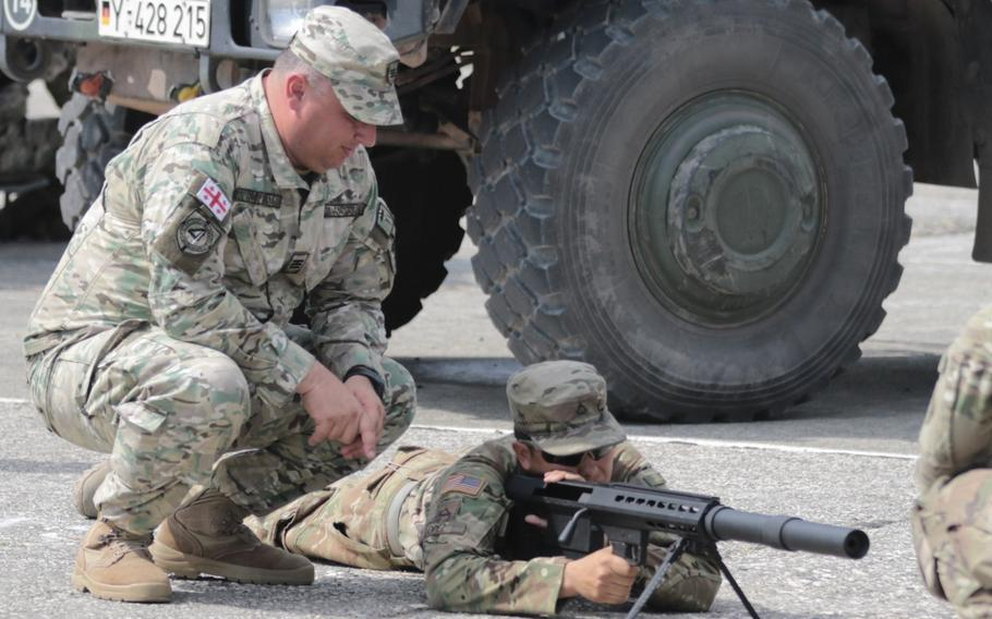 Pfc. Schuyler T. Lopez, an infantryman with the Vilseck, Germany based 2nd Cavalry Regiment, gets familiar with a Georgian PDShP2 anti-materiel rifle prior to the opening ceremonies of Noble Partner at the Vaziani Training Area, Georgia on Aug. 1, 2018. The U.S. military and Georgian Armed Forces have trained and fought together side by side in Iraq and Afghanistan for more than 15 years.