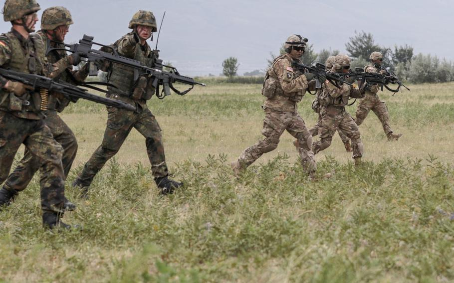 U.S. Army and German soldiers advance during an assault training mission at the Vaziani Training Area, Georgia on Aug. 1, 2018. Noble Partner18 incorporates units from 13 countries, contributing to a stable and secure environment in the Black Sea region.