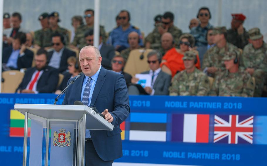 Giorgi Margvelashvili, President of Georgia, speaking at the Noble Partner 18 opening ceremony at the Vaziani Airfield, Georgia, on Aug. 1, 2018. Noble Partner 2018 is an annual Georgian and U.S. Army Europe exercise. It is intended to support and enhance the readiness and interoperability during a multinational training operation.