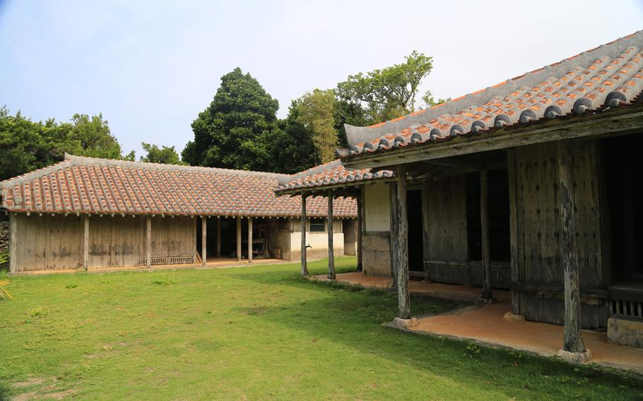 In Izena Island's Nakada Village, traditional Okinawan houses are preserved for visitors.