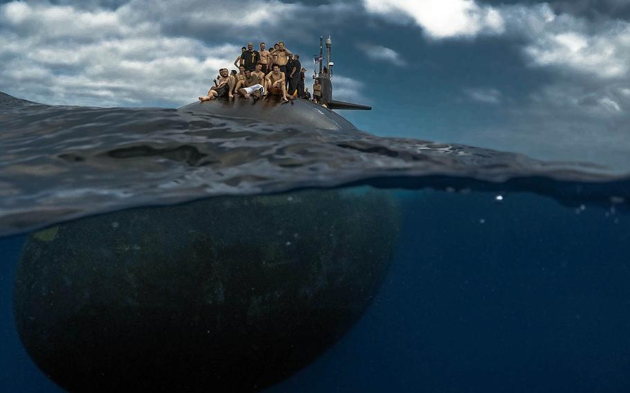 Submariners from the Pearl Harbor-based USS Olympia participate in a swim call in the Pacific Ocean, July 31, 2018.