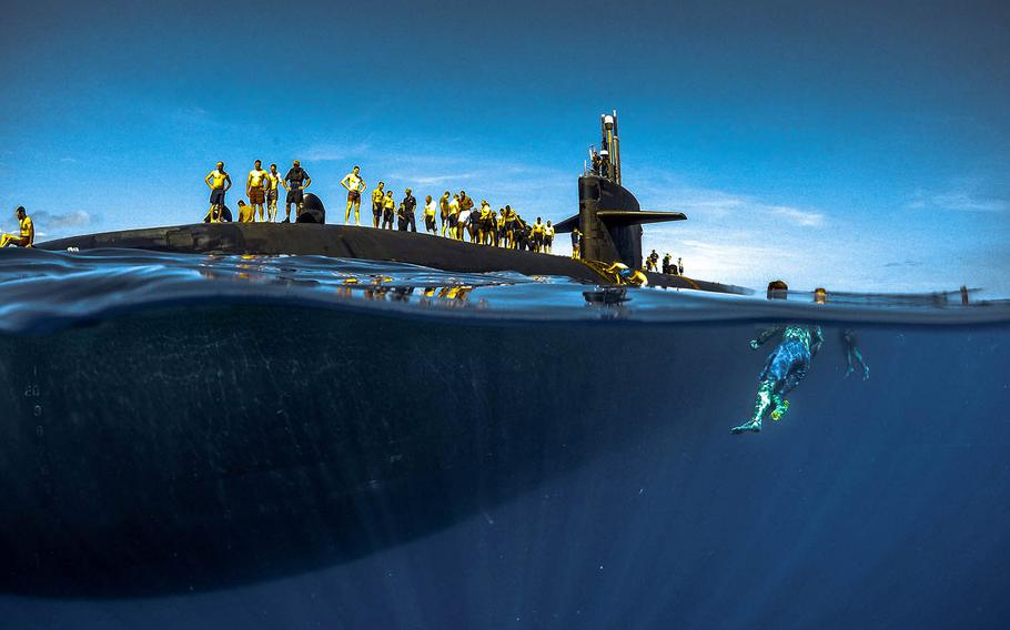 Sailors assigned to Los Angeles-class fast-attack submarine USS Olympia swim in the Pacific Ocean, July 31, 2018.