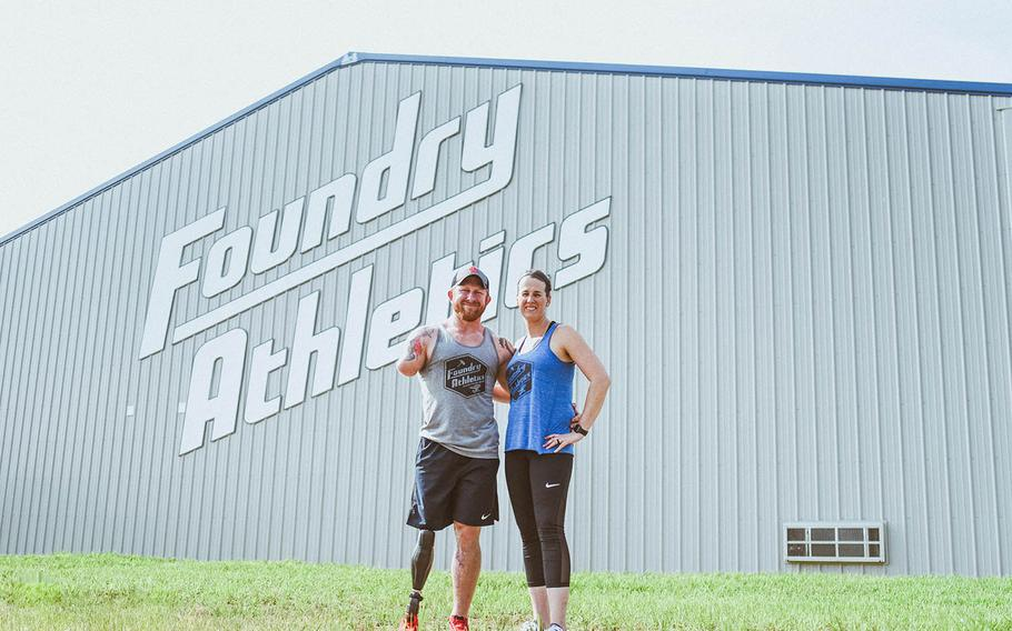 Jared Bullock, a former Green Beret, and his wife Jesica stand outside Foundry Athletics, a gym they opened May 19, 2018, in Carterville, Ill.