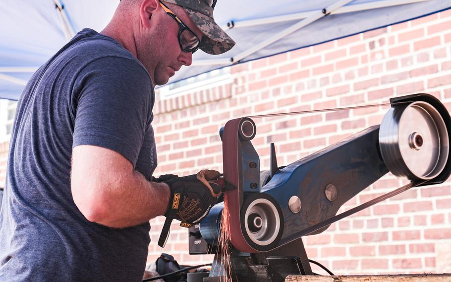 Sgt. 1st Class Keith Shugarts works on a knife he's forging at the Workhouse Arts Center in Lorton, Va. The Center is home to Recovery Forge, a veteran-run program that teaches forging skills to servicemembers, veterans and first responders.