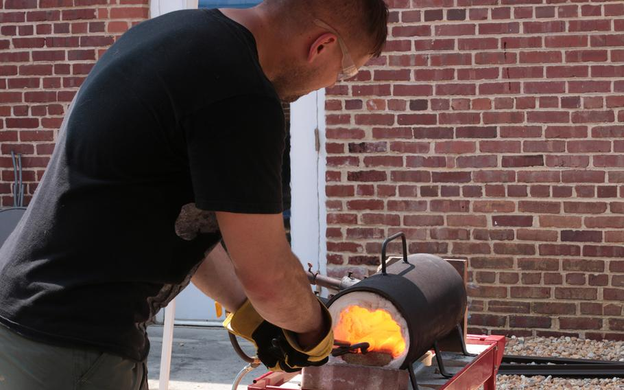 Sgt. Eric Lang, an Army reservist, works on forging a blade at the Workhouse Arts Center in Lorton, Va., on Aug. 11, 2018.