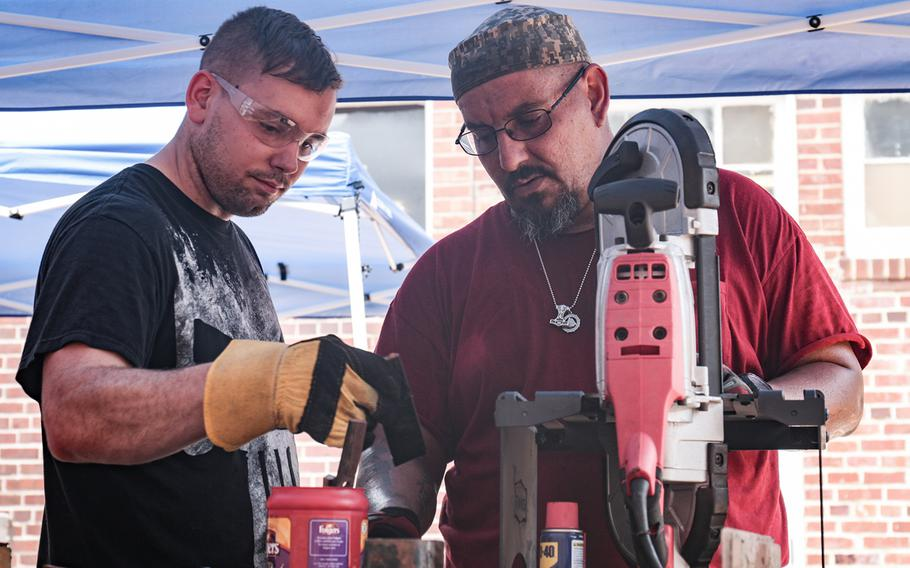 Adam Porras, right, gives some forging advice to Army Reserve Sgt. Eric Lang on Aug. 11, 2018 as part of Recovery Forge. Military veterans Adam and Donna Porras run Recovery Forge in Lorton, Va. The program teaches forging skills to servicemembers, veterans and first responders.