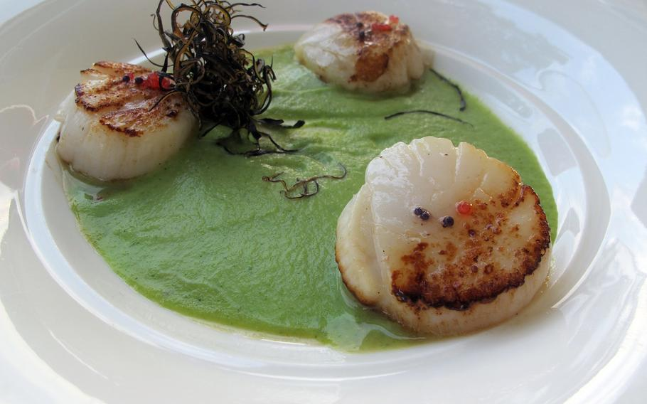 Scallops on a broccoli puree with lumpfish roe are one of several appealing appetizers offered by Arcimboldo in Sirmione, Italy, serves.