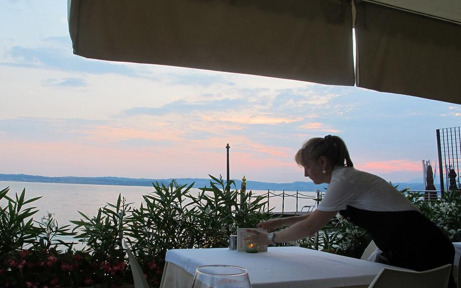 The restaurant Arcimboldo in Sirmione, Italy, has seating on a terrace on the shore of Lake Garda, where diners can watch ferry boats glide by in the sunset. Service is friendly and efficient.