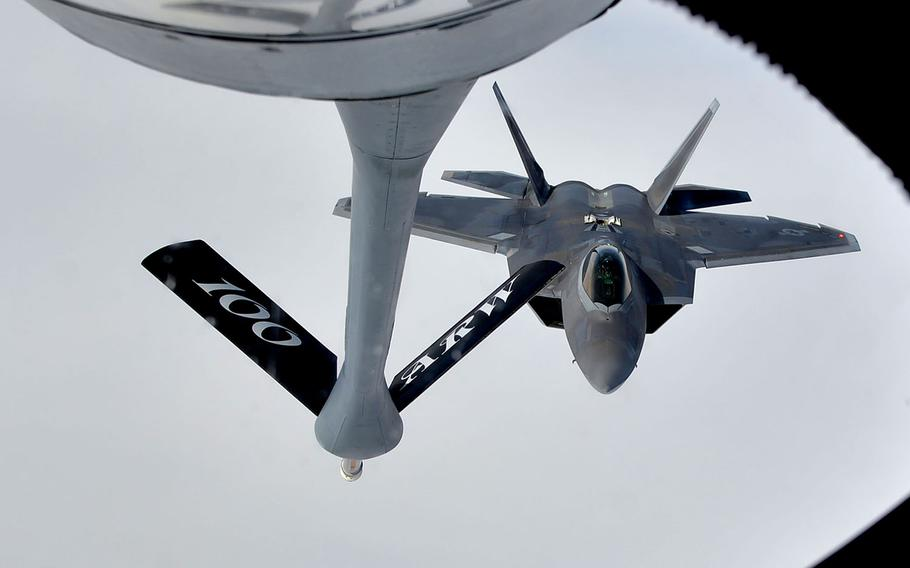 A U.S. Air Force F-22 Raptor comes in for an aerial refueling from a KC-135 Stratotanker of the RAF Mildenhall-based 100th Air Refueling Wing, over Norway, Wednesday, Aug. 15, 2018.