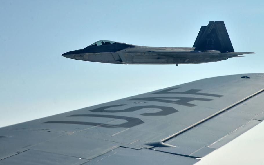 A U.S. Air Force F-22 Raptor of the 325th Fighter Wing flies off the wing of a KC-135 Stratotanker of the 100th Air Refueling Wing after taking on fuel on its way to Norway, Wednesday, Aug. 15, 2018. Two Raptors were joined in the air by two Norwegian air force F-35s.