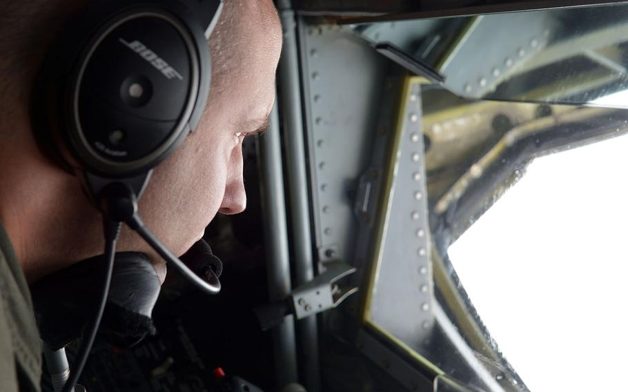 Tech Sgt. Justin Miller, a boom operator on a RAF Mildenhall-based KC-135 Stratotanker of the 100th Air Refueling Wing, waits for a F-22 Raptor to show up for an aerial refueling over Norway, Wednesday, Aug. 15, 2018.