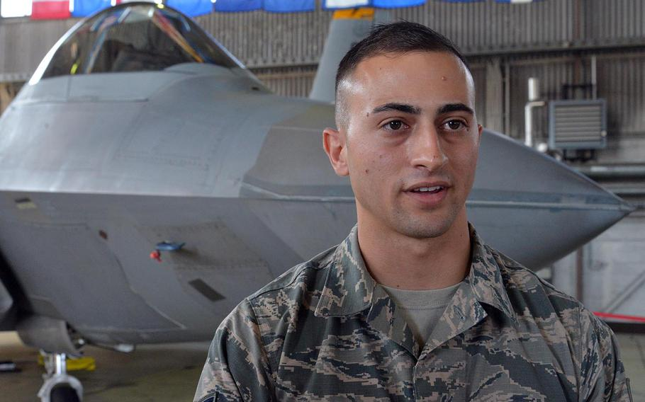 Staff Sgt. Nicholas Chaplin, a F-22 avionics technician talks about taking care of the fifth-generation aircraft while deployed. Behind him is one of the Raptors that are deployed to Spangdahlem Air Base, Germany from Tyndall Air Force Base, Florida.