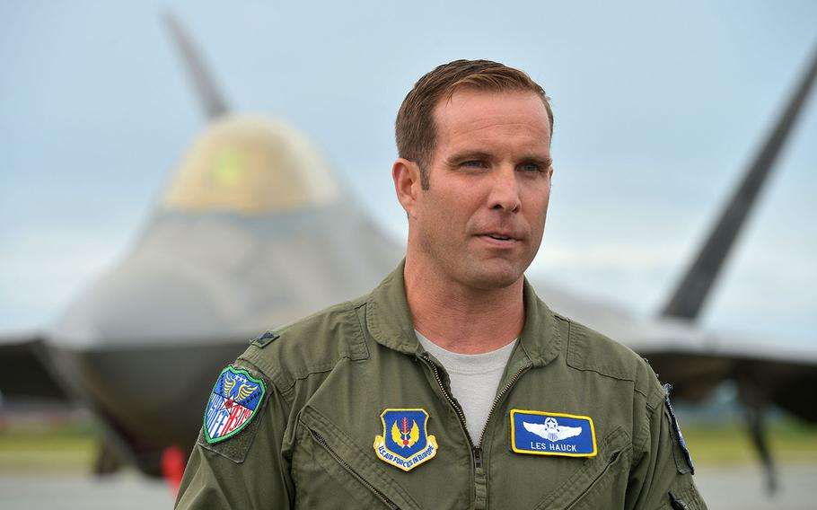 U.S. Air Force Col. Les Hauck talks to reporters at Orland Main Air Station, Norway, Wednesday, Aug. 15, 2018. Behind him is a USAF F-22 Raptor that flew in from Spangdahlem Air Base, Germany.
