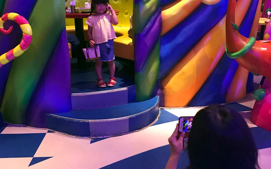 Guests at Kawaii Monster Cafe in the trendy Tokyo neighborhood of Harajuku are free to explore and take photographs inside the uniquely decorated space.