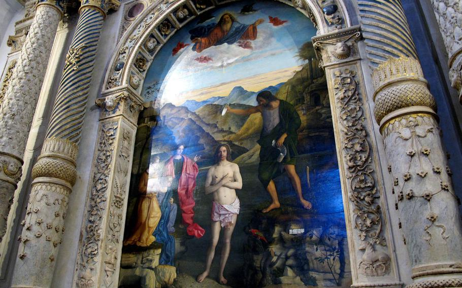 """""""The Baptism of Christ"""" by Giovanni Bellini dates to 1500 to 1502 and is considered the crown jewel of the paintings in the Chiesa di Santa Corona in Vicenza, Italy."""