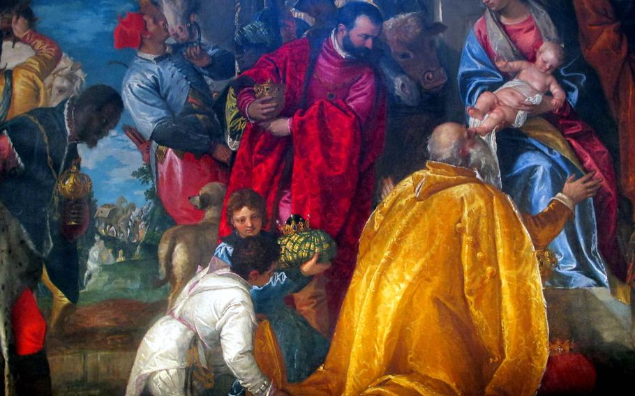 """""""The Adoration of the Magi"""" in the Chiesa di Santa Corona was painted in 1580 by Paolo Veronese and is lushly colored and crowded with people, animals and divinities. Notice the man kissing the horse."""