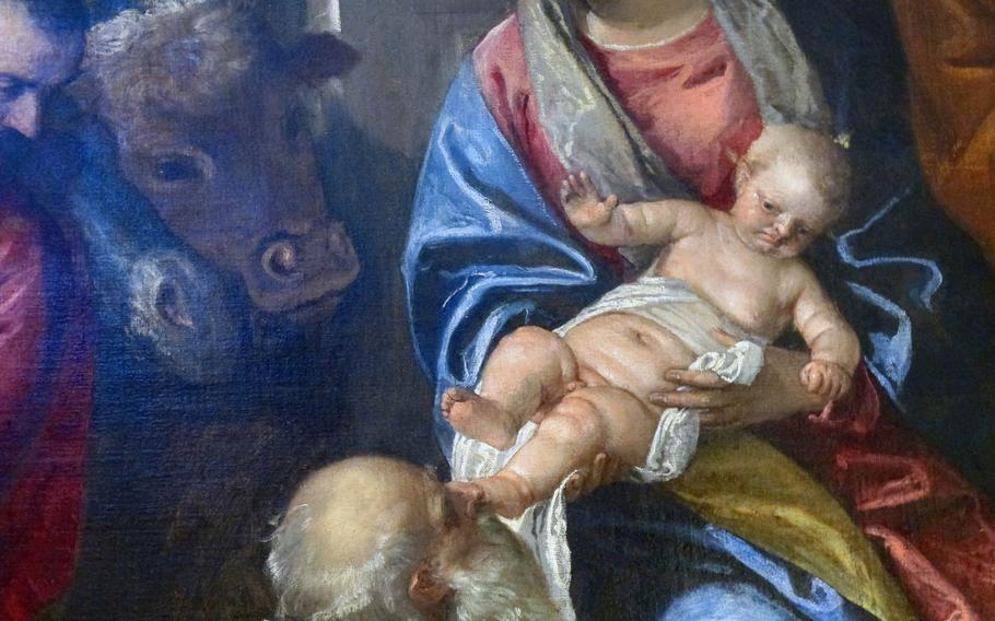 """A close-up of the baby Jesus in Veronese's """"The Adoration of the Magi"""" in the Chiesa di Santa Corona in Vicenza, Italy, shows something rarely seen in Renaissance art: a baby Jesus who's none too thrilled that a Magi is kissing his foot."""