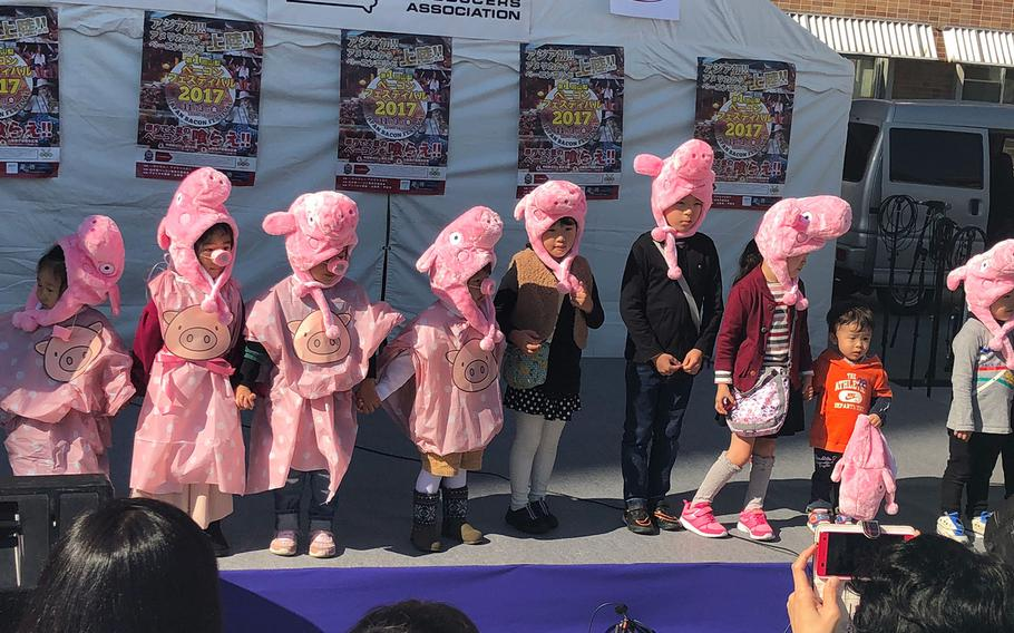 """Children participate in the """"Piglet Parade"""" on Nov. 3, 2017, during the Japan Bacon Festival in Kofu, Japan."""