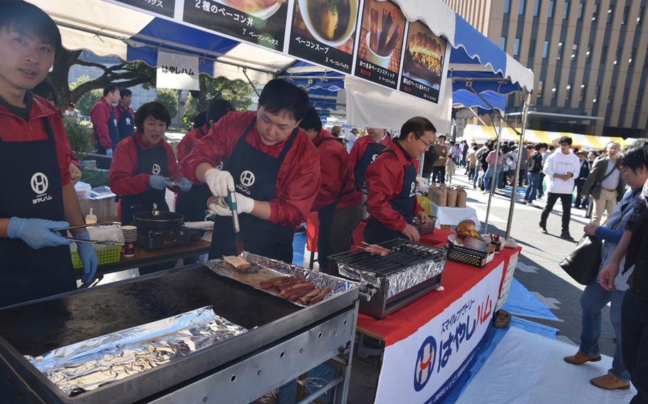 Vendors prepare bacon for hungry festival-goers at the Japan Bacon Festival on Nov. 3, 2017, in Kofu, Japan.