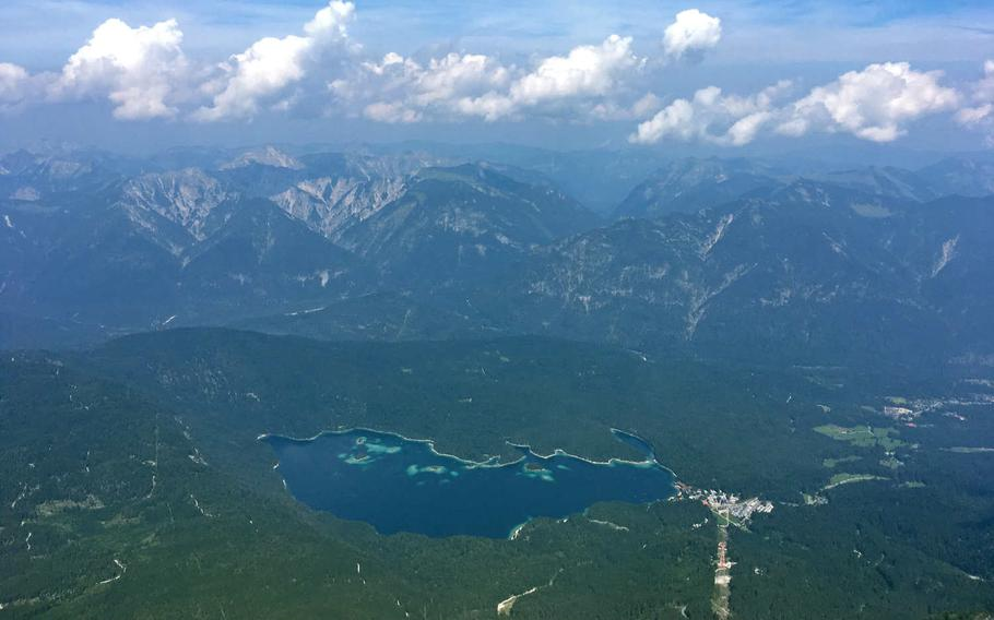 The view from the top of the Zugspitze, Germany's highest mountain. The lake at the base of the mountain is the  Eibsee.