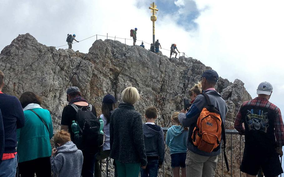 Visitors to the Zugspitze, Germany's tallest mountain near Garmisch-Partenkirchen, can climb to the very peak of the mountain, but it is a little risky.